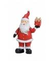 Kerstman beeldje met kado 9 cm