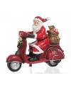 Kerstman op scooter beeldje 18 cm